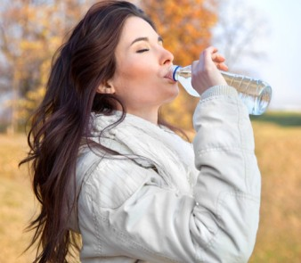 woman-drinking-bottled-water-outside